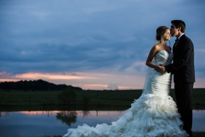 Bride and Groom Lakeside at Sunset